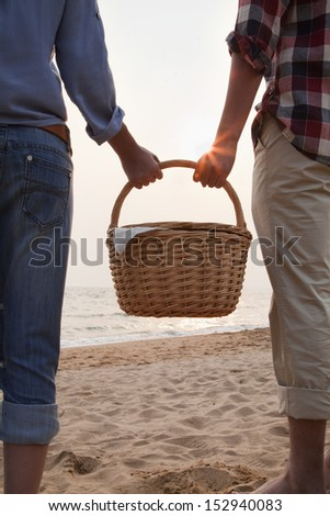 Young Couple Holding Picnic Basket - stock photo