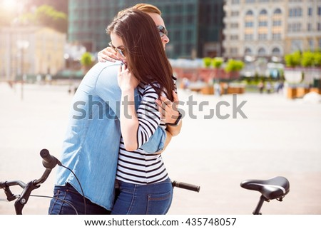 Young couple hugging in the city - stock photo