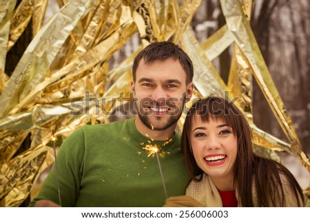 Young couple hugging in winter weather - stock photo