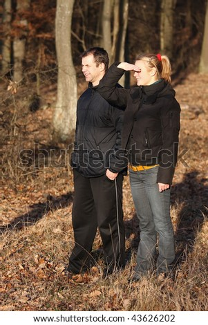 Young couple in a beautiful autumn excursion - stock photo