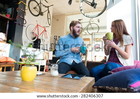 Young Couple in a cafe - stock photo