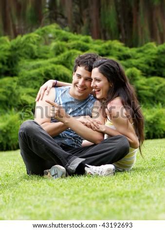 young couple in a summer garden - stock photo