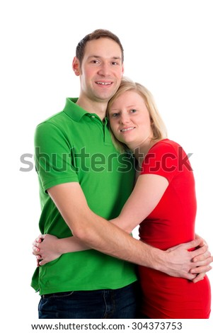 young couple in an embrace in front of white background - stock photo