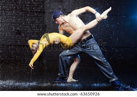 Young couple in aqua studio - stock photo