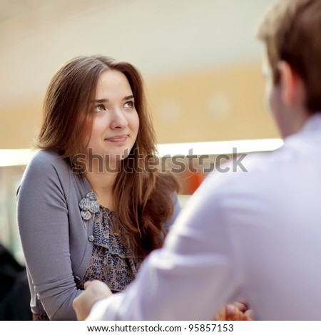 young couple in cafe rendezvous - stock photo