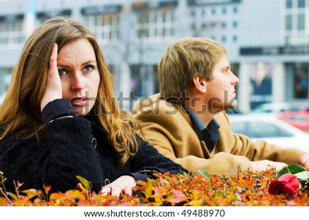 Young couple in conflict on city street - stock photo