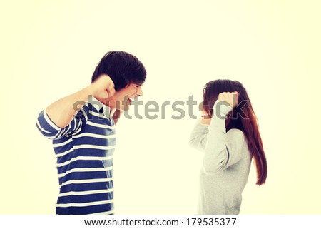 Young couple in conflict shouting each other - stock photo