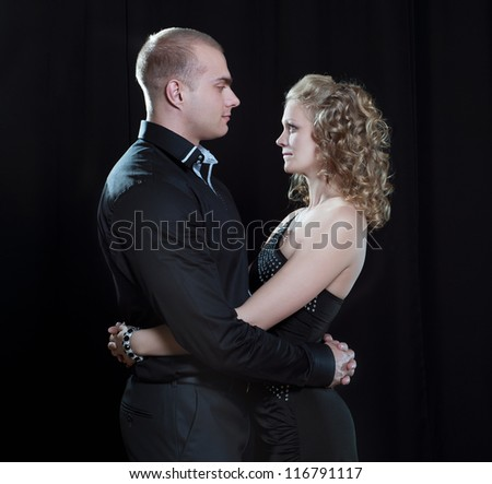 young couple in elegant evening dresses - stock photo