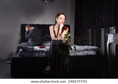 Young Couple in Formal Wear Fighting for Something While at the Bedroom - stock photo