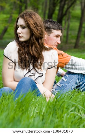 Young couple in little quarrel - stock photo