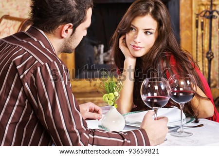 Young couple in love and red wine - stock photo