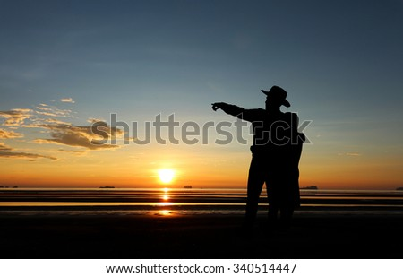 Young couple in love at  beautiful sunset. - stock photo