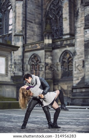 Young couple in love dance outdoors in old town - stock photo