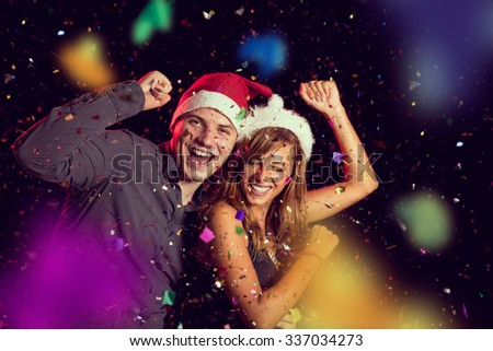 Young couple in love dancing at New Year's Eve party and having fun - stock photo