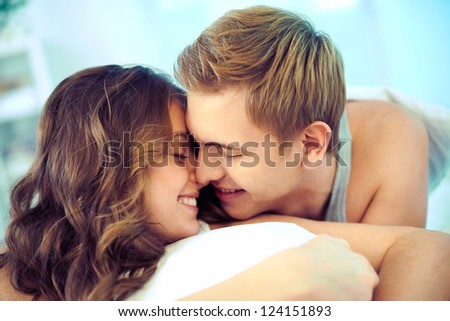 Young couple in love expressing their tenderness and affection - stock photo