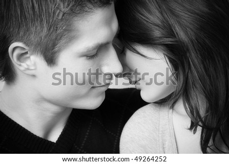 young couple in love, face to face in black and white - stock photo