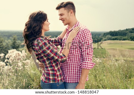 Young couple in love in the countryside - stock photo