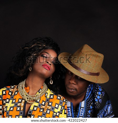 Young couple in love indoor. Portrait of young attractive couple dressed in bright national costume. Stunning sensual outdoor portrait of young stylish fashion couple posing in studio. - stock photo