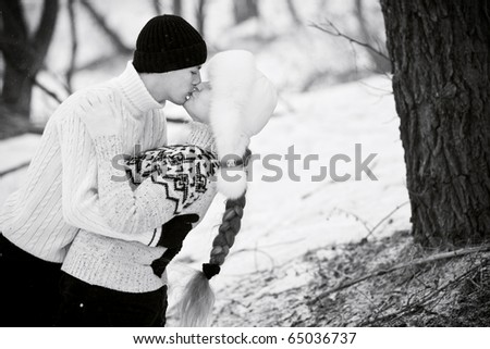 Young couple in love kissing and hugging (B/W) - stock photo