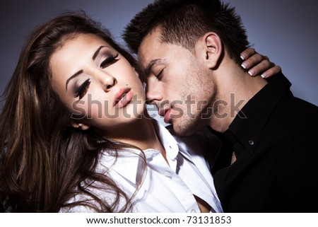young couple in love kissing, studio shot - stock photo