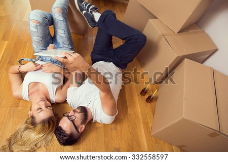 Young couple in love moving in a new flat - stock photo