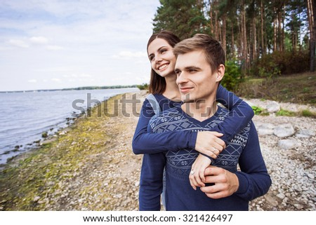 Young couple in love on a beach - stock photo