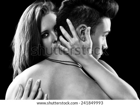 Young couple in love on black background - stock photo