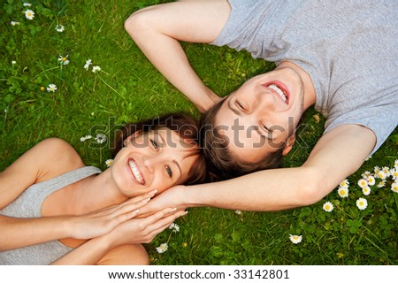 Young couple in love outdoors - stock photo