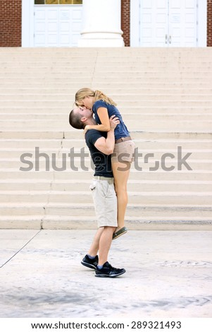 Young Couple In Love Smiling and Happy Hugging Boyfriend and Girlfriend Engaged Professional Photography of Caucasian Couple  - stock photo