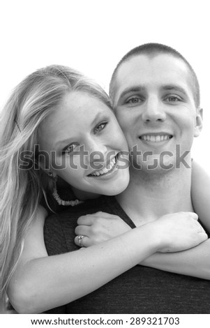 Young Couple In Love Smiling and Happy Hugging Boyfriend and Girlfriend Engaged Professional Photography of Caucasian Couple Black and White - stock photo