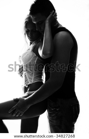 young couple in love, studio white, back light - stock photo