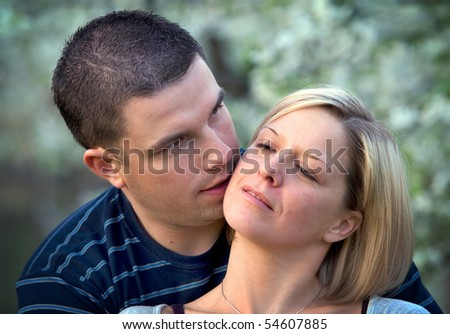 Young couple in love together in romantic scenery - stock photo