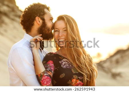 Young couple in love walking in the park holding hands looking in the sunset, blurry photos -Concept