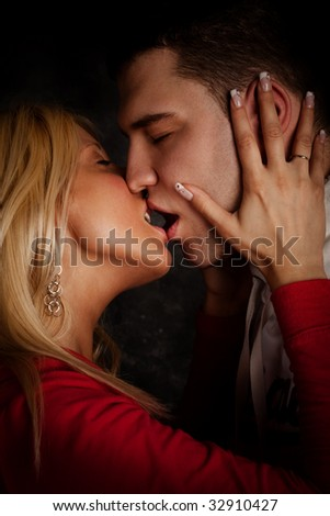 young couple in passion kiss, studio shot - stock photo