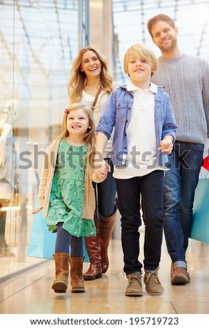 Young Couple In Shopping Mall Together  - stock photo