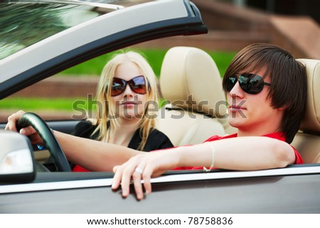 Young couple in the convertible - stock photo