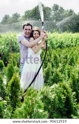 young couple in the garden - stock photo