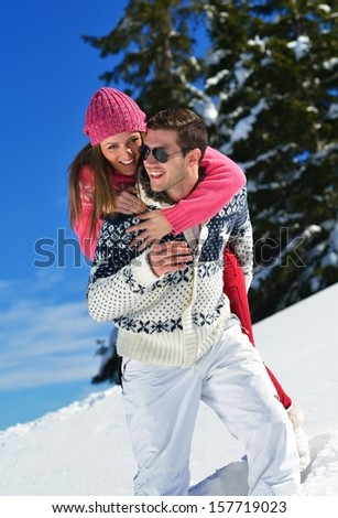 Young Couple In winter Snow Scene at  beautiful sunny day - stock photo