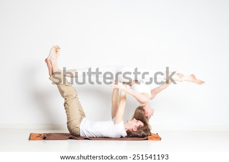 Young couple in yoga pose - stock photo