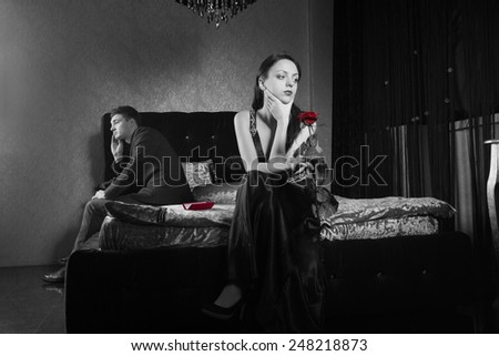 Young Couple Inside the Bedroom Fighting for Something. Captured in Gray Scale. - stock photo