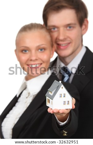 young couple isolated holding home - stock photo