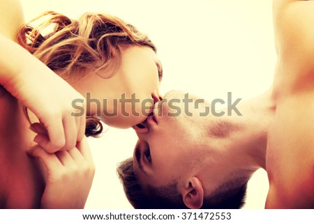 Young couple kissing. - stock photo