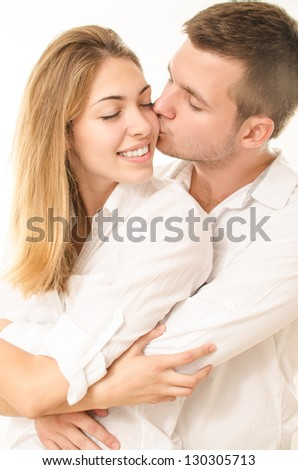 young couple kissing and hugging - stock photo