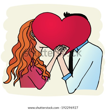 young couple kissing holding heart in hands - stock photo
