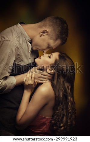 Young Couple Kissing in Love, Fashion Woman Man Romantic Passion Desire, Intimate Emotions of Lovers  - stock photo