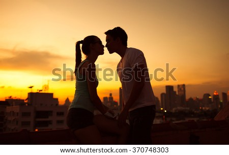 Young couple kissing in the city - stock photo