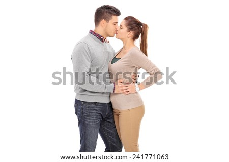 Young couple kissing isolated on white background - stock photo