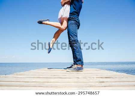 Young couple kissing on the beach - stock photo