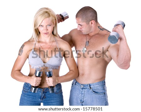 Young couple lifting weights isolated on white - stock photo