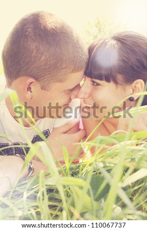 Young couple looking into each others eyes - stock photo